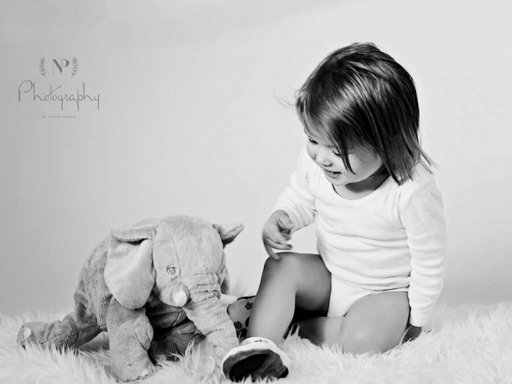 little girl plays with elephant